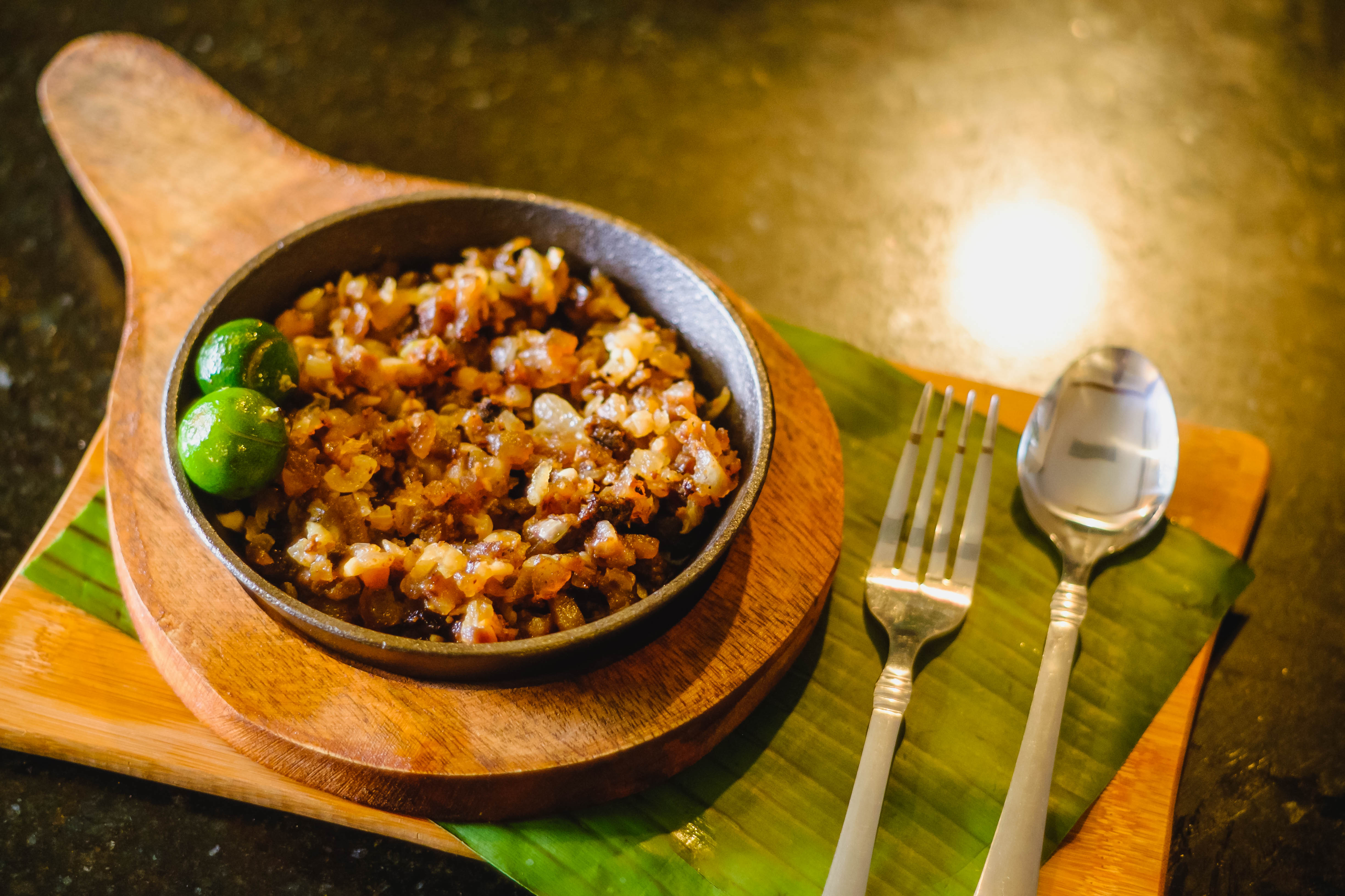 Andrew Zimmern Delicious Destinations Manila - Chopped deep fried pig face, ears, liver and meat
