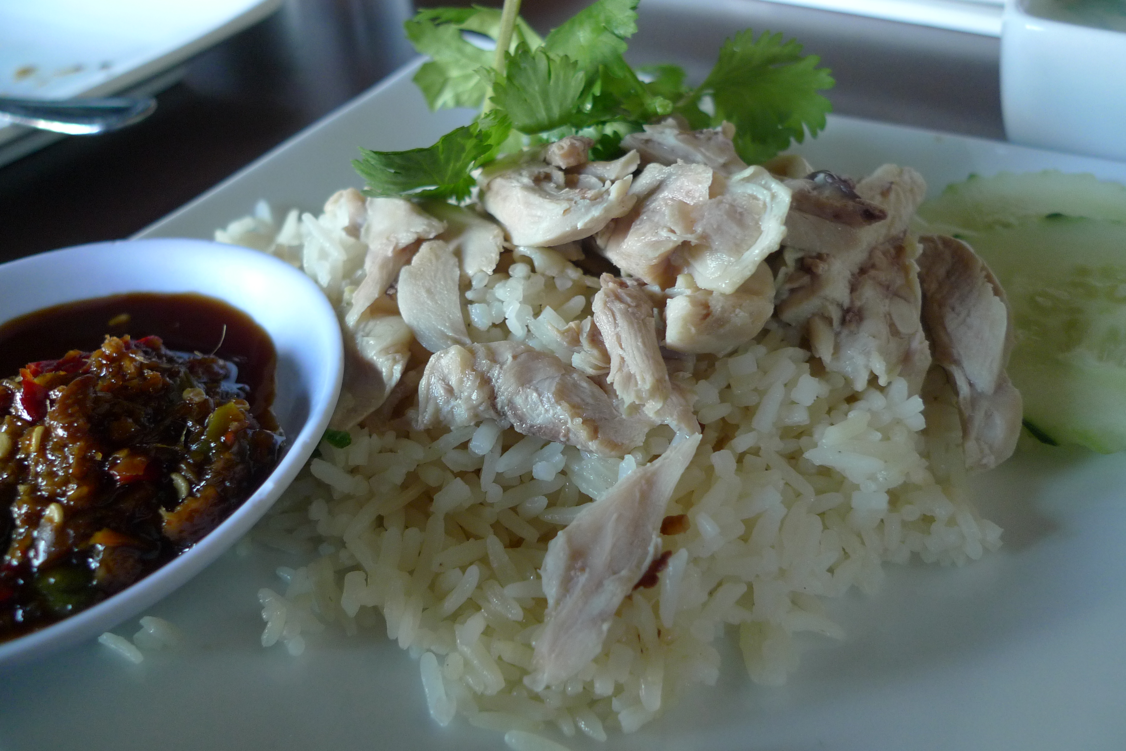 Delicious Destinations Singapore - Chicken rice topped with chopped chicken breast and a chili dipping sauce