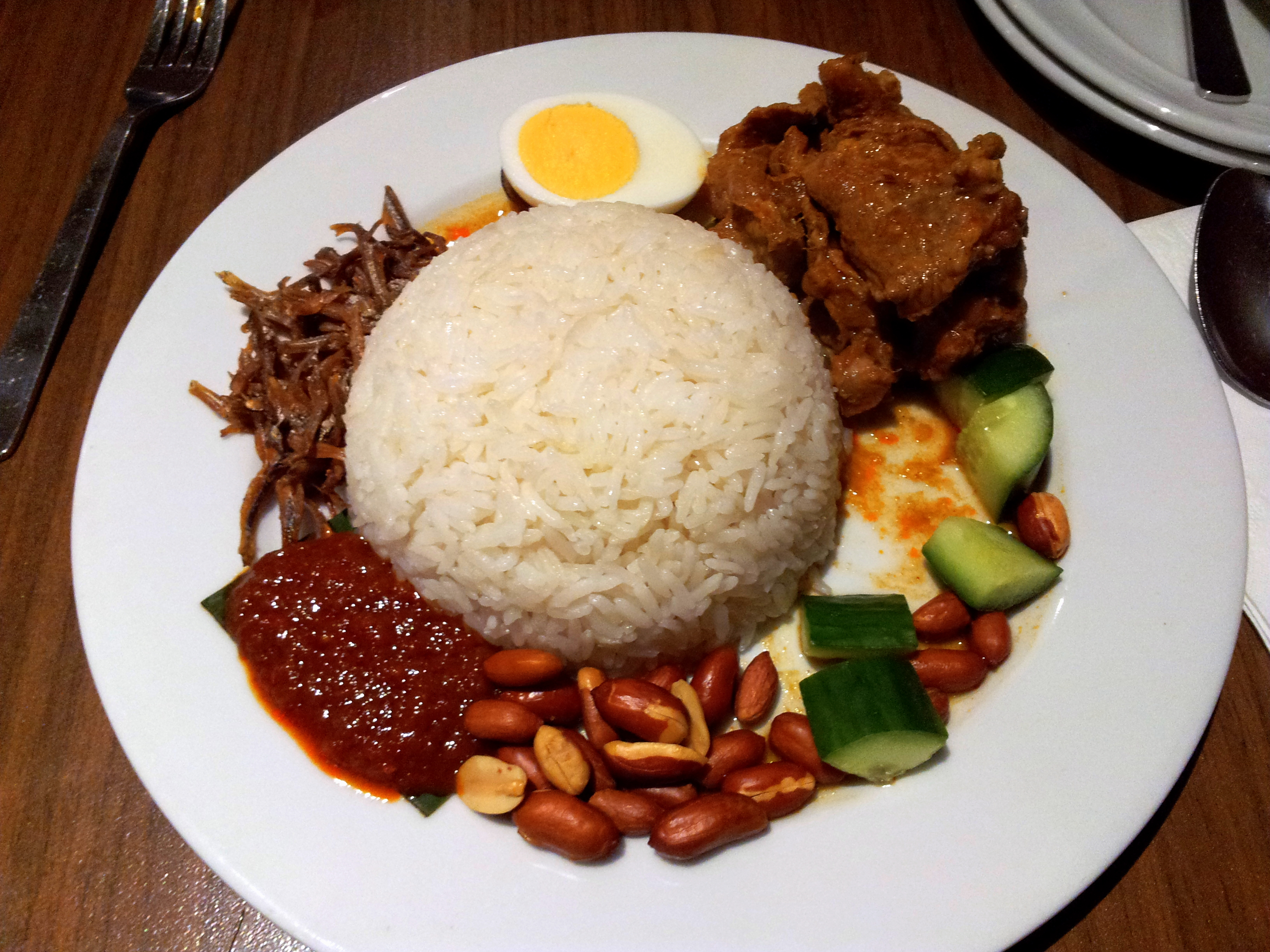 Basmati rice with side dish of chili sauce, cucumber, nuts, chicken, egg and dried fish