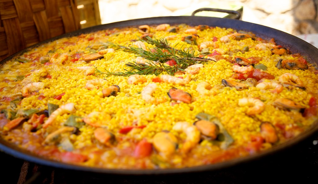 Delicious Destinations Barcelona - A mixture of cooked rice, shrimp, squid, clams, mussel, other sea food and vegetables