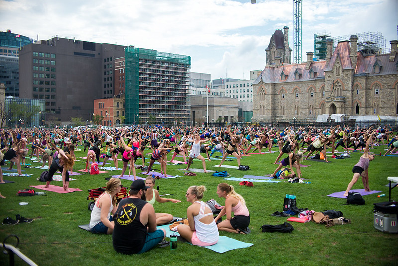 free things to do in Ottawa - summer yoga in the Parliament Hill grounds - photo by David D under CC BY 2.0