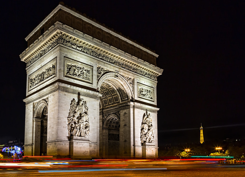Arc de Triomphe at night - photo by Sheila Sund under CC BY 2.0