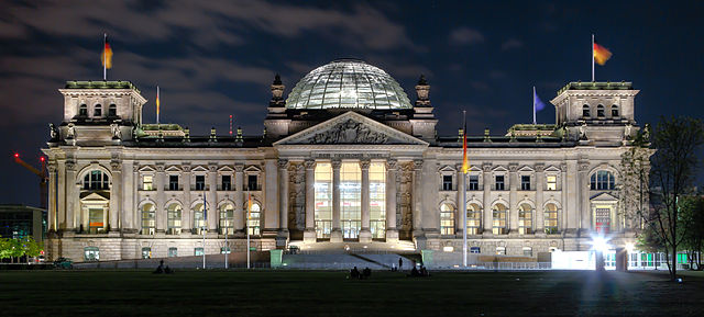 historical sites in berlin - Reichstag building at night - photo by Avda under CC-BY-SA-3.0