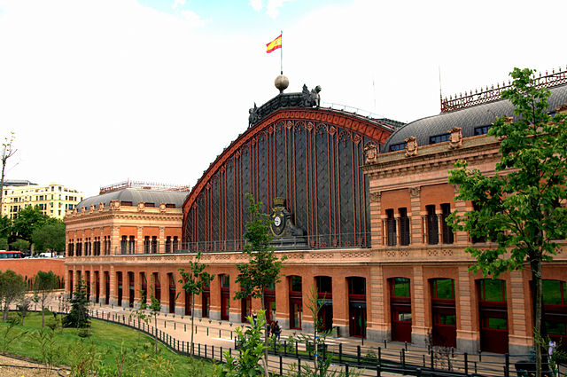 northwest façade of Atocha railway station in Madrid - photo by Manuel M. Vicente from Spain under CC-BY-SA-2.0