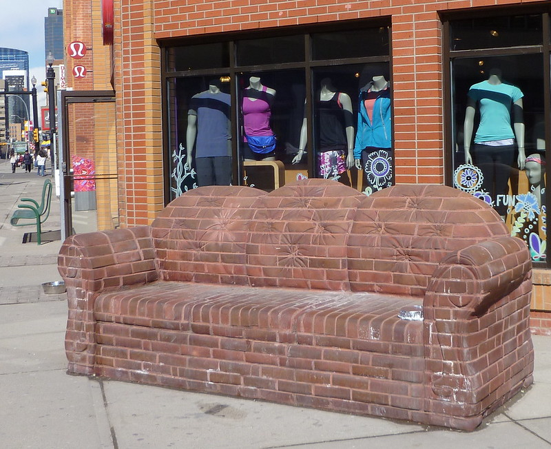 best shopping in Calgary - Brick couch sculpture on 4th Street SW, Mission District, Calgary - photo by Bill Longstaff under CC BY-SA 2.0