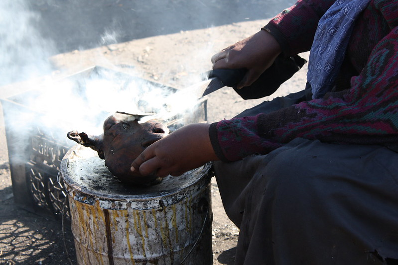"""Anthony Bourdain South Africa - A woman making a """"smiley"""" - photo by Kim Nowacki under CC BY-ND 2.0"""