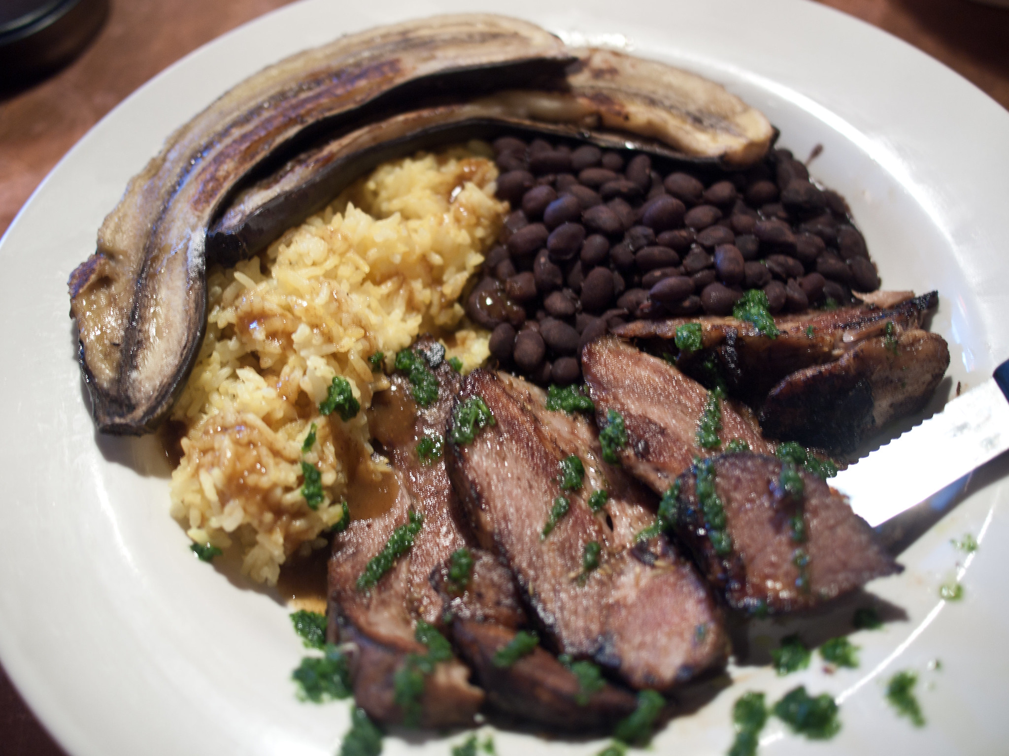 Anthony Bourdain Cuba - Cuban Pork with Black Beans and Rice - photo by Edsel Little under CC BY-SA 2.0