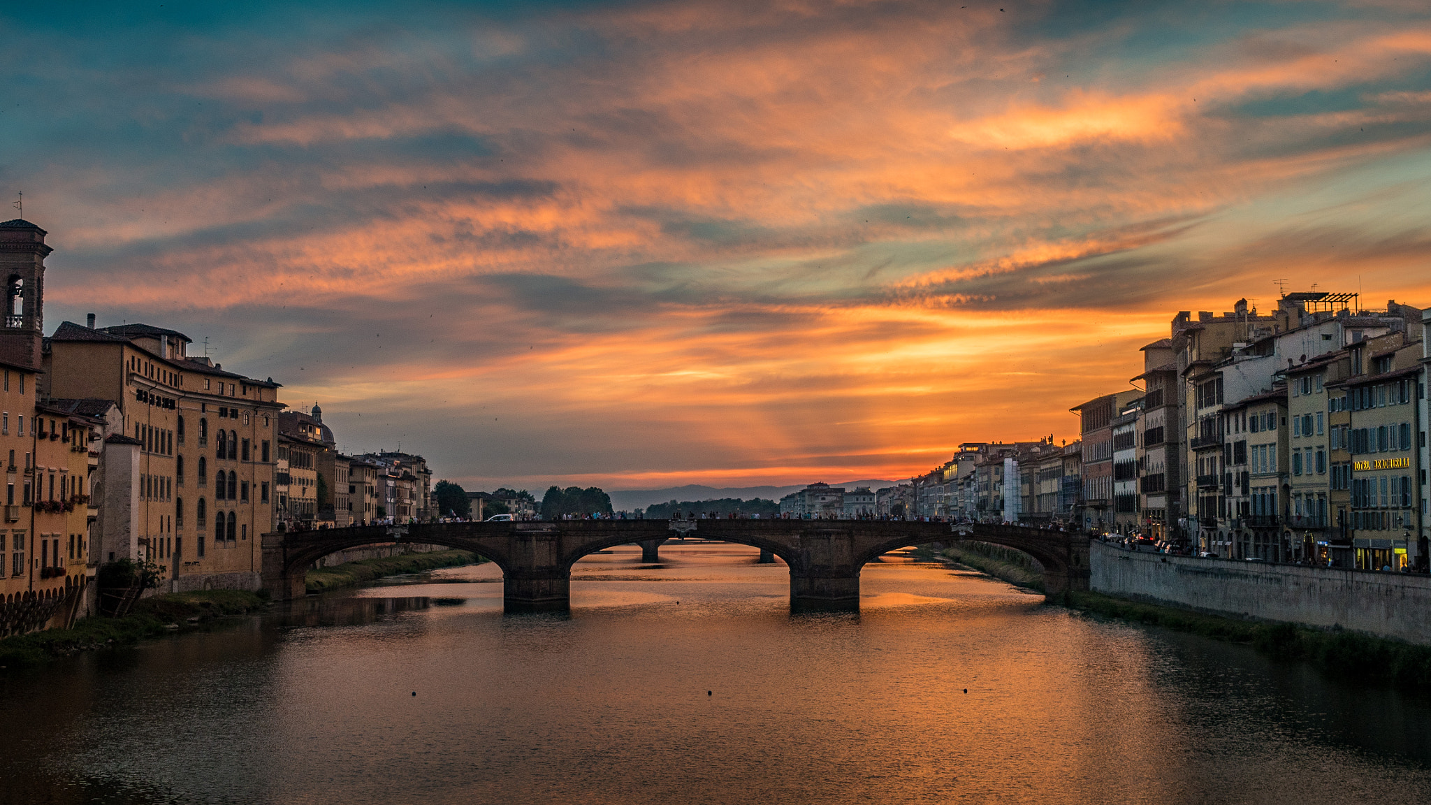 Sunset over the Arno River in Florence, Italy - photo by Peter Teoh under CC-BY-SA-3.0