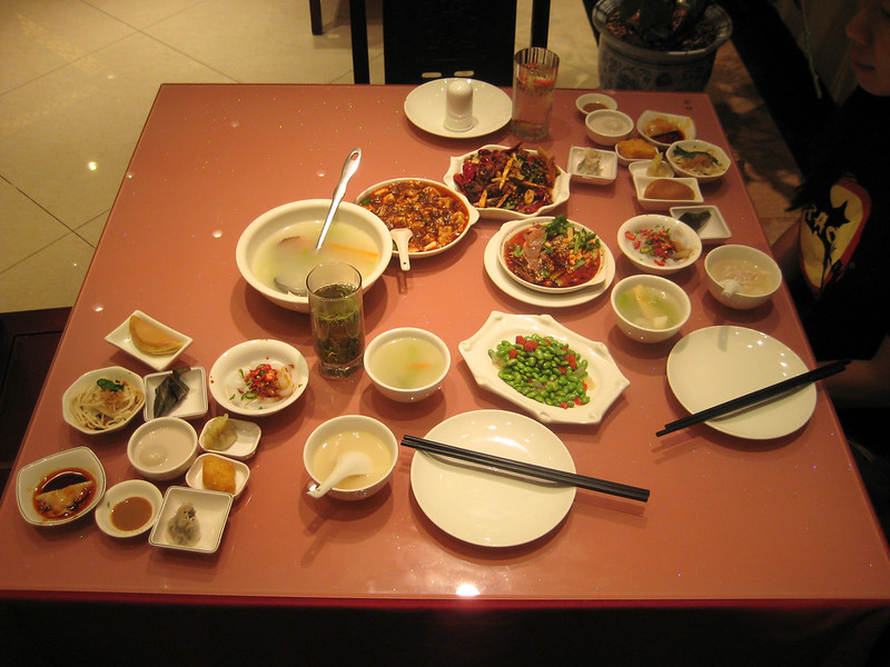 Anthony Bourdain Sichuan - Sichuan dinner with an array of appetizers, soup and main dishes - photo by rduta under CC BY 2.0
