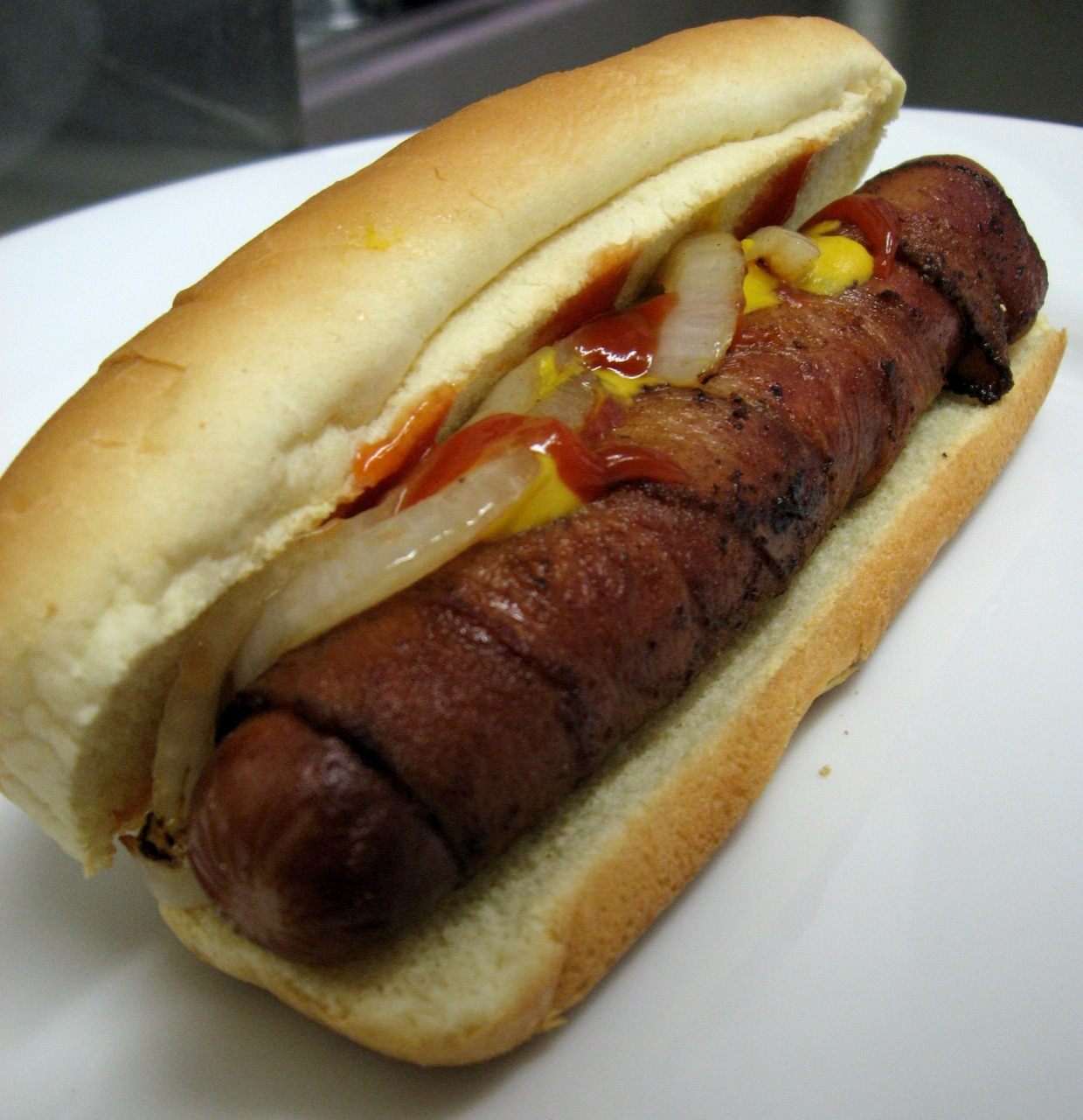 Bacon-wrapped Hot Dog - photo by Arnold Gatilao under CC BY 2.0