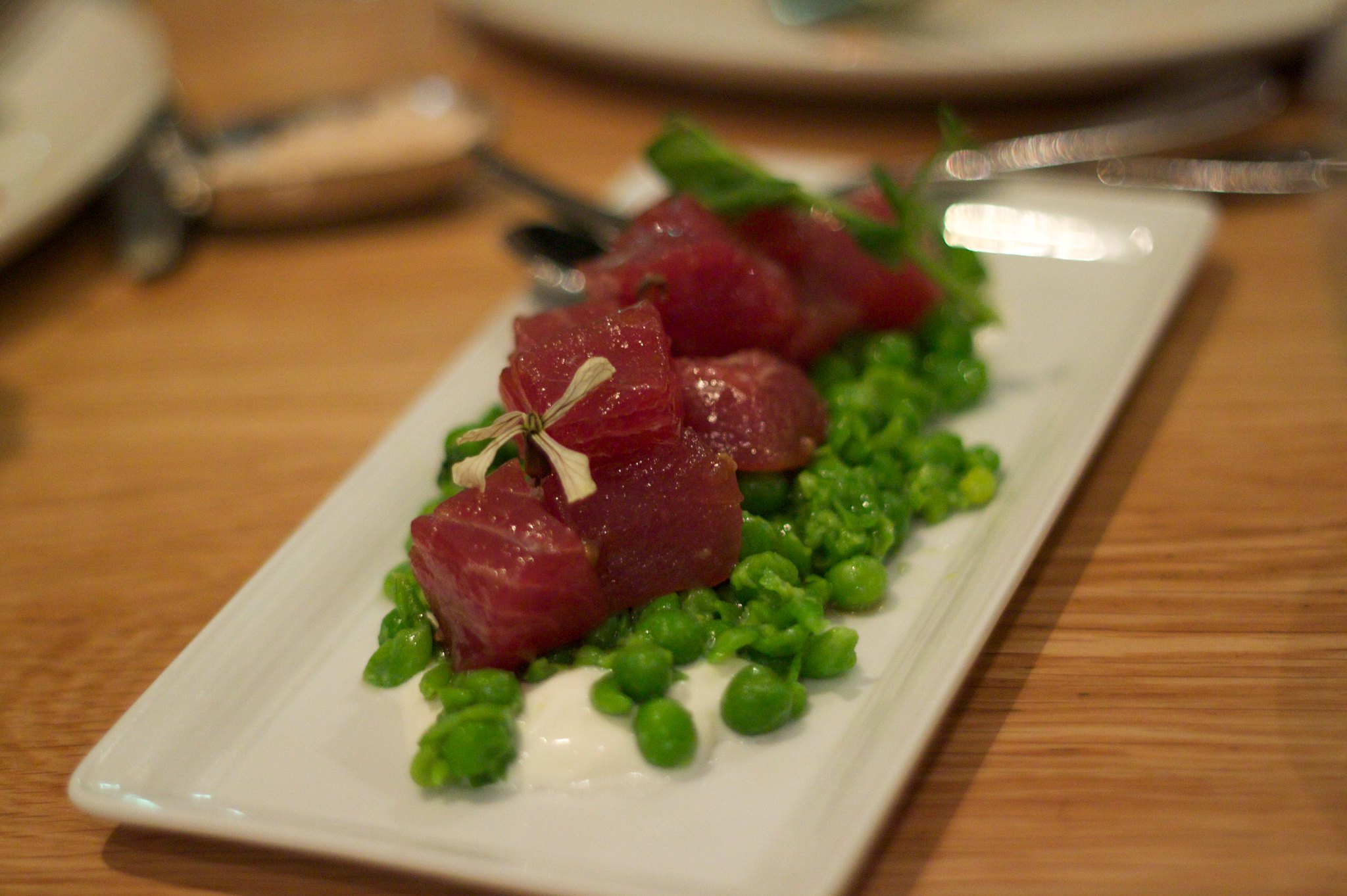 tuna tartare with crushed green pea salad - photo by Tristan Kenney under CC BY 2.0