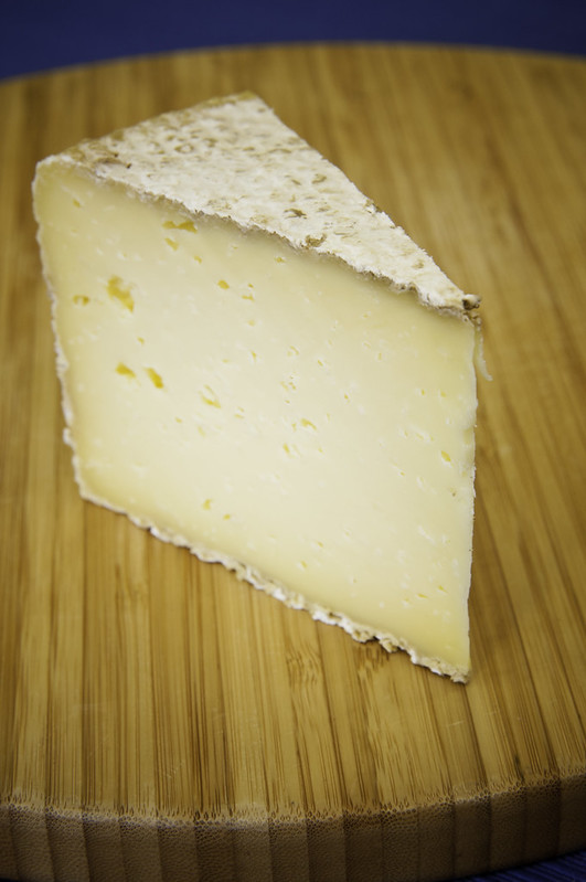 Cave-aged Cheddar - photo from USDA Photo by Bob Nichols under CC BY 2.0
